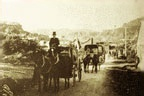 Photograph of a horse drawn cart funeral procession.
